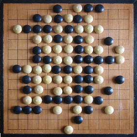 the board and the pieces of the Gomoku board game